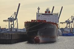 Hamburg - Container vessel with contre-jour Royalty Free Stock Photography