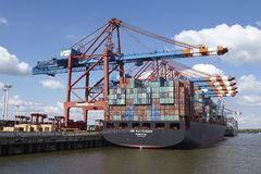 Hamburg - Container vessel at Eurokai. The container vessel Zim Rotterdam is loaded/unloaded at the container terminal Eurokai in Hamburg-Waltershof on May 2014 Stock Image
