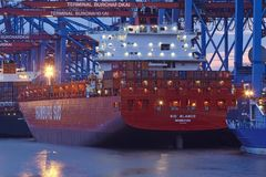 Hamburg - Container vessel loaded and unloaded at terminal Stock Photos