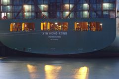 Hamburg - Container vessel at the port in the evening Royalty Free Stock Images