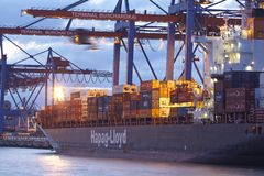 Hamburg - Container vessel at terminal in the evening Stock Photography