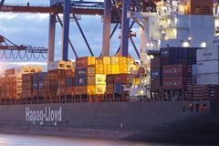 Hamburg - Container vessel at terminal in the evening Royalty Free Stock Photos