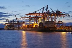 Hamburg - Container vessel at terminal in the evening Royalty Free Stock Photo