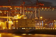 Hamburg - Container vessel at terminal (night) Royalty Free Stock Photo