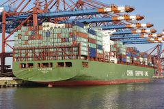 Hamburg - Container vessel at terminal Stock Photo