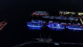 Aerial view of waterfront night illuminated view of Port of Hamburg, Germany. Hamburg downtown Financial district city roads buildings office skyscrapers ferry stock video footage