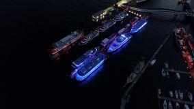Aerial view of waterfront night illuminated view of Port of Hamburg, Germany. Hamburg downtown Financial district city roads buildings office skyscrapers ferry stock footage