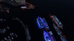 Aerial view of waterfront night illuminated view of Port of Hamburg, Germany. Hamburg downtown Financial district city roads buildings office skyscrapers ferry stock video