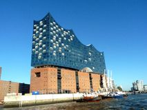 Hamburg, elbphilharmonie and modern buildings at harbor royalty free stock images