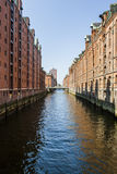 Hamburg: Famous Speicherstadt warehouse district. HAMBURG, GERMANY - April 16, 2009: Canal and restored traditional commercial buildings (Speicherstadt) in Stock Image