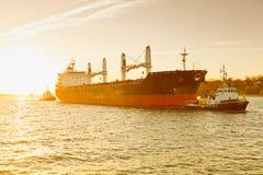 Hamburg, fright ship is towed by tug boat, Elbe. Germany, Hamburg, fright ship is towed by tug boat, Elbe royalty free stock image