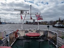 Hamburg, Germany - April 22, 2016 Deserted upper deck of a HADAG harbour ferry at Wind day. Royalty Free Stock Photo