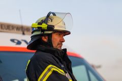 Hamburg, Germany - April 18, 2013: HDR - firefighter chief observed the fire service.  Royalty Free Stock Image