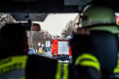 Hamburg, Germany - April 18, 2013: HDR - firefighter on the street in the fire truck in action Stock Photos
