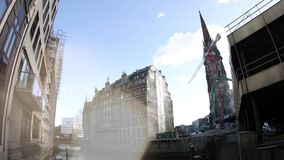 Demolishing house office in Hamburg Germany. HAMBURG, GERMANY - CIRCA 2018: Construction site destroying demolishing the building for a new house office building stock video footage