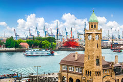 Hamburg, Germany. Famous Hamburger Landungsbruecken with harbor and traditional paddle steamer on Elbe river, St. Pauli district, Hamburg, Germany Stock Photo