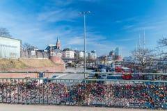 Love padlocks at entrance bridge to Landungsbrucken railway station royalty free stock photography