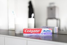 Hamburg, Germany 01.19.2018 illustrative editorial of Colgate Shine Crystals MaxWhite toothpaste. In front of bathroom mirror Royalty Free Stock Photography