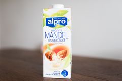 Hamburg, Germany 01.19.2018 illustrative editorial of unsweetened alpro roasted almond milk. Drink in beverage carton on kitchen table Stock Photo
