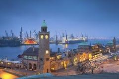 Hamburg, Germany. Image of Landungsbruecken and the harbor at night in Hamburg, Germany Stock Image