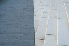 Hamburg. The pavement is divided by a line with a staircase on the city`s waterfront as a background stock photos