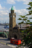 HAMBURG, GERMANY - JULY 18, 2016: Beautiful view of famous Landungsbruecken with commercial harbor and Elbe river, blue sky, cloud Stock Photos