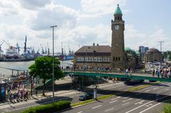 HAMBURG, GERMANY - JULY 18, 2016: Beautiful view of famous Landungsbruecken with commercial harbor and Elbe river, blue sky, cloud stock photo