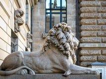 Hamburg, Germany - July 03, 2018: View at Lion sculpture at entrance to courtyard at Townhall Hamburg. stock photography
