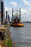 HAMBURG, GERMANY - JULY 18,2015: yellow Tug Boat in the port of Hamburg at the pier Stock Photos