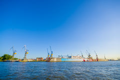 HAMBURG, GERMANY - JUNE 08, 2015: Beautiful view of port in Hamburg, big boats ans ships making some work. Various. Cranes working stock images