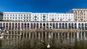 Exterior view of the Alsterarkaden and the lake Kleine Alster in. HAMBURG, GERMANY - JUNE 5, 2016: Exterior view of the Alsterarkaden and the lake Kleine Alster Stock Images