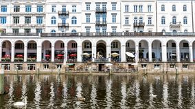 Exterior view of the Alsterarkaden and the lake Kleine Alster in. HAMBURG, GERMANY - JUNE 5, 2016: Exterior view of the Alsterarkaden and the lake Kleine Alster Royalty Free Stock Image