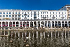 Exterior view of the Alsterarkaden and the lake Kleine Alster in. HAMBURG, GERMANY - JUNE 5, 2016: Exterior view of the Alsterarkaden and the lake Kleine Alster Royalty Free Stock Images