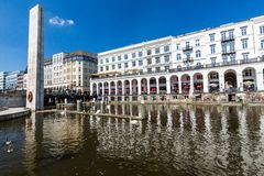 Exterior view of the Alsterarkaden and the lake Kleine Alster in. HAMBURG, GERMANY - JUNE 5, 2016: Exterior view of the Alsterarkaden and the lake Kleine Alster Stock Photography