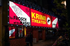 Hamburg, Germany - June 23, 2018: The Krimi Theater at night showing an old German movie on the Reeperbahn. Hamburg, Germany - June 23, 2018: The Krimi Theater Royalty Free Stock Photos
