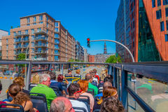 HAMBURG, GERMANY - JUNE 08, 2015: Red light stops the bus in the middle of the road, sightseeing bus around Hamburg Stock Photography