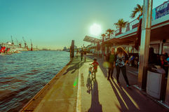 HAMBURG, GERMANY - JUNE 08, 2015: River pier on Hamburg, at the end of the day people can walk and go out with bycicles. And childs Stock Photos