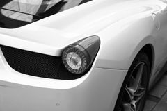 White supercar Ferrari 458 Spider. Hamburg, Germany - JUNE 14, 2016: Stoplight of a white sports car Ferrari 458 Spider since 2011. Ferrari is famous expensive Royalty Free Stock Images