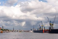 Hamburg, Germany - June 30, 2014: View at shipyard Blohm + Voss and touristic part of Port of Hamburg, Speicherstadt and Hafencity. At day with cloudy sky stock image