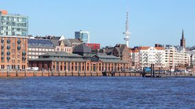 HAMBURG, GERMANY - MARCH 8th, 2014: river Elbe and the famous Fischmarkt fish market , Fischauktionshalle.  Royalty Free Stock Photography