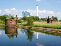 Hamburg, Germany - May 19, 2016: Old abandoned control cabins at a pond with reflecting watersurface. Royalty Free Stock Images