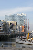Hamburg, Germany - The new Elbphilharmonie. HAMBURG, GERMANY - NOVEMBER 14: In background the 110-meter high building stands prominently near the landing bridges Royalty Free Stock Photos