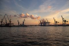 Cranes at Hamburg Harbour at Sunset. HAMBURG, GERMANY - November 11, 2018: Cranes at Hamburg Harbour at Sunset royalty free stock images