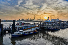 HAMBURG GERMANY - NOVEMBER 01 2015: Tourists embark for the last harbor tour at the famous gangways of the harbor of Stock Images