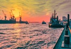 Hamburg, Germany - November 01, 2015: Tug boat at the quai of harbor Hamburg waits for the next tug job in the evenning. stock photo