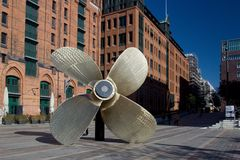Big Ship Propeller. HAMBURG, GERMANY - OCTOBER 12, 2015: Giant four-blade ship propeller in front of the International Maritime Museum in Hamburg`s Speicherstadt Royalty Free Stock Photography