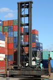 Stacked Shipping Containers and Empty Container Handler Stock Photos