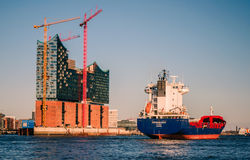 Hamburg-Elbphilharmonie. Hamburg, Germany, viewed from the riverside on the south of the river Elbe. The Elbphilharmonie under construction and a big container royalty free stock photo
