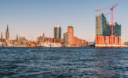 Hamburg-Elbphilharmonie. Hamburg, Germany, viewed from the riverside on the south of the river Elbe. The Elbphilharmonie under construction is visible on the royalty free stock images