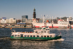 Hamburg, view from the south. Hamburg, Germany, viewed from the riverside on the south of the river Elbe. The famous ship Cap San Diego and the church St royalty free stock photography